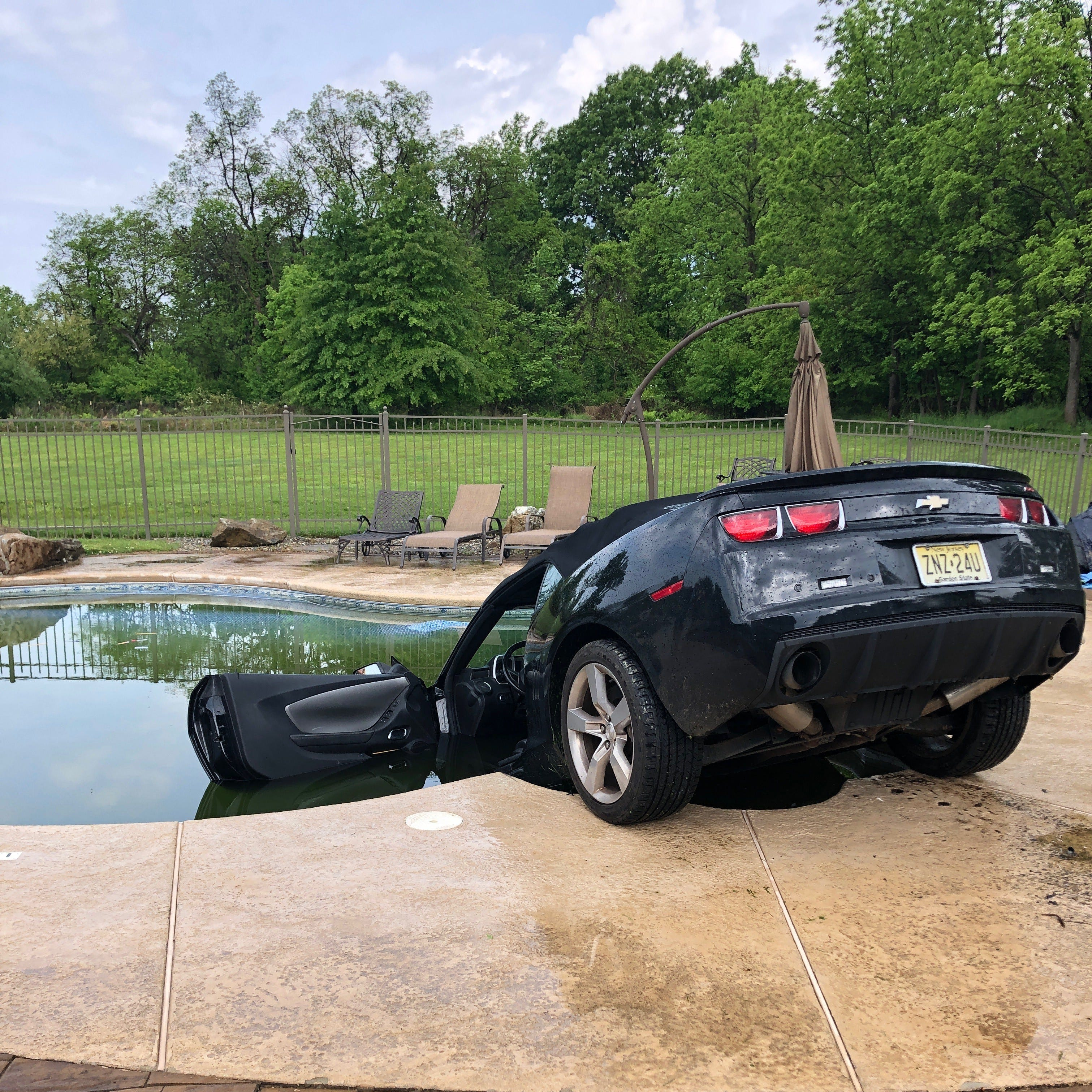 Readington man drives car into swimming pool