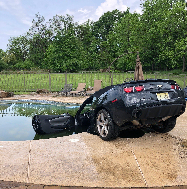 Readington man drives car into swimming pool