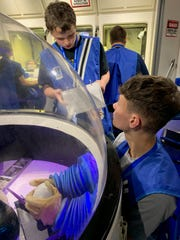 Lucas Maleszewski and Ethan Brenly of River Junior High School participating in a simulated space mission at the Challenger Learning Center at Wheeling Jesuit University.