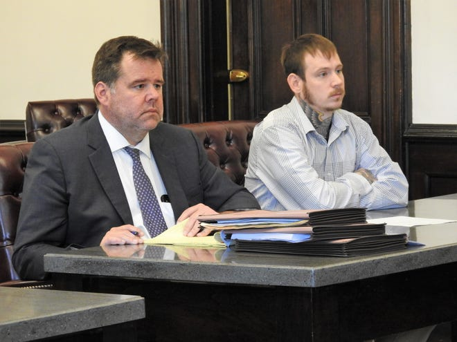 Attorney David Hanson appears with client Joseph Brewer in Coshocton County Common Pleas Court during a previous hearing in this Tribune file photo. Brewer was recently sentenced to 15 years in prison for charges relating to an Oct. 29 home invasion.