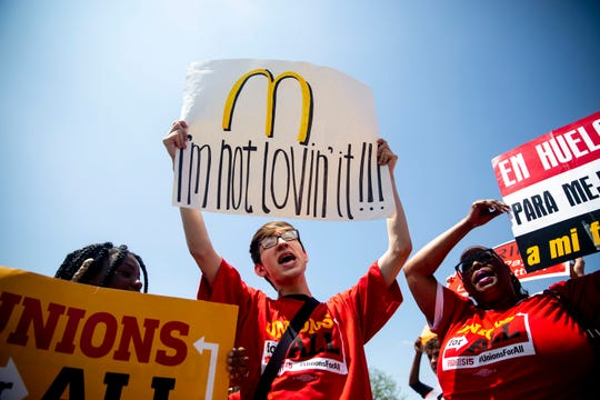 Protestors hold signs and chant outside of the McDonald's on Merle Hay Road on Thursday, May 23, 2019, during a rally calling for a $15 minimum wage, in Des Moines. Fight for 15 protests were held across the country today.
