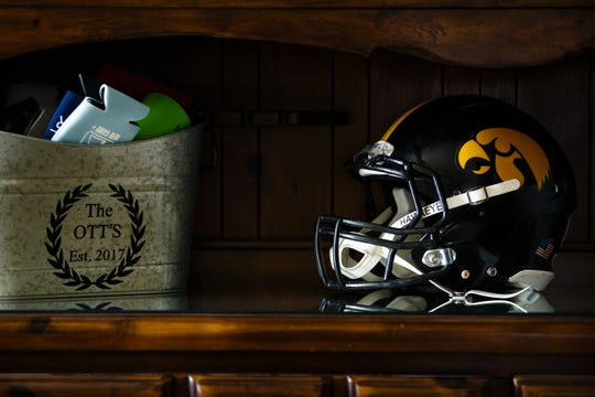 The helmet Drew Ott wore during his playing days at Iowa sits on a cupboard in he and his wife Kali's home in Trumbull, NE on Thursday, May 16, 2019.