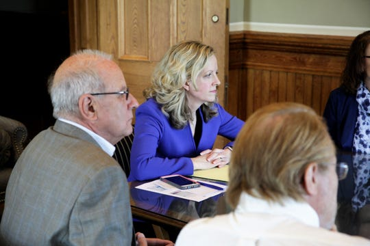 Sen. Janet Petersen, D-Des Moines, met with members of SNAP in her office after a news conference Wednesday. They vowed to continue their work on statute of limitations reforms even though the session is over.