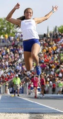 Aliyah Carter jumps during the state meet at Drake Stadium.