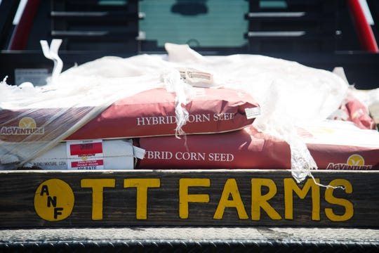 """Ott Farms"" is painted on the back of one of the families trucks as they load seed into bins to be planted on Thursday, May 16, 2019, in Trumbull, NE."
