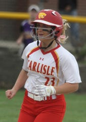 Carlisle junior Kennedy Preston rounds the bases after hitting a game-tying home run against Indianola.