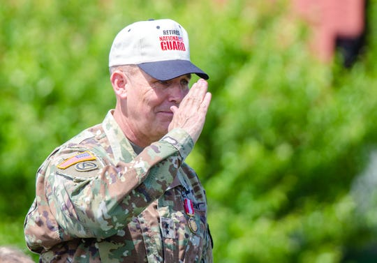 Retiring Maj. Gen. Tim Orr salutes the troops after putting on his Retired National Guard hat during a command retreat ceremony at Camp Dodge on May 23, 2019.
