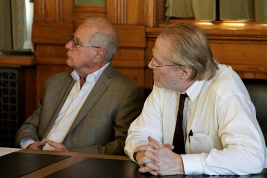 Tim Lennon (left) and John Chambers (right), both of SNAP, listen to Sen. Janet Petersen speak at a Wednesday news conference renewing calls for statute of limitations reform. Both men were abused in Iowa dioceses as teenagers.
