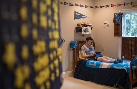 Detroit Lions Superfan Danny Ervin, 17 relaxes at home in his room in Bloomfield Hills, Mich., Monday, May 20, 2019.