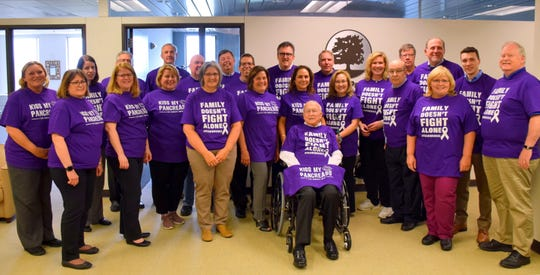 Coworkers of  Oakland County Executive L. Brooks Patterson gather with their boss on May 21, 2019, in shirts that show their support for his pancreatic-cancer treatment.