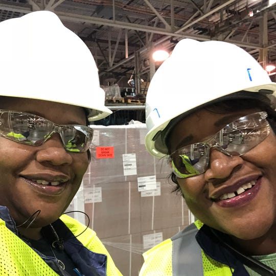 Ventura Robinson, left, and Michelle Fountaine, right, daughter and mother millwright apprentices, hope to complete their training together in approximately four years. To complete required plant hours, they work at the Cleveland Engine Plant in Ohio between training and assessment at the UAW-Ford Technical Training Center. They are pictured here in Ohio on May 20, 2019.