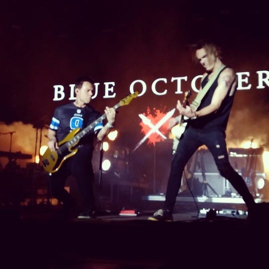 "Matt Noveskey, left, plays bass guitar in the band ""Blue October."" He's also a staunch Detroit Lions fan and calls Matthew Stafford his ""hero."""