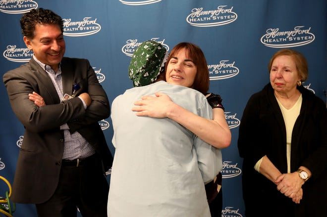 Michelle Rachuk, of Waterford gets a hug from perfusionist Michelle Benavente as Dr. Majid M Al-Zagoum and Rachuk's mother, Joanne Rachuk watch the moment at the Henry Ford Macomb Hospital in Clinton Township on Wednesday, May 22, 2019.