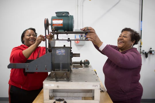 Ventura Robinson (left) and Michelle Fountaine (right), daughter and mother apprentices, train on May 13, 2019 to complete their millwright skilled trades apprenticeship. Ford has invested $35 million in the UAW-Ford Technical Training Center in Lincoln Park to help train its hourly workforce.