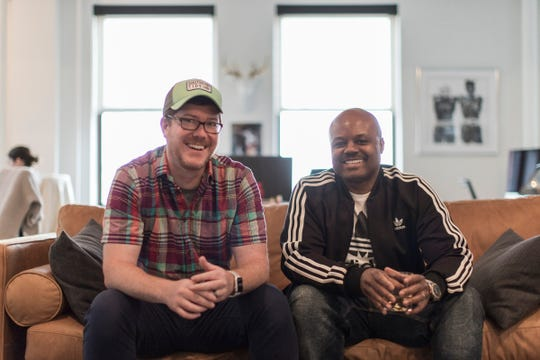 First Fight co-owners Guy Allen and AndrŽ Foster pose for a photo at their office in downtown Detroit, Thursday, May 9, 2019.