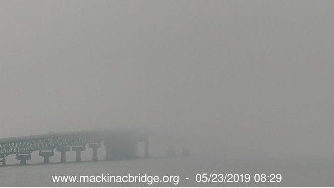 Fog envelops the Mackinac Bridge on May 23.