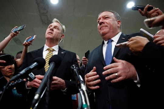 In this May 21, 2019, photo, acting Defense Secretary Patrick Shanahan, left, and Secretary of State Mike Pompeo speak to members of the media after a classified briefing for members of Congress on Iran on Capitol Hill in Washington. U.S. officials say the Pentagon will present plans to the White House to send up to 10,000 more American troops to the Middle East to beef up defenses against potential Iranian threats.
