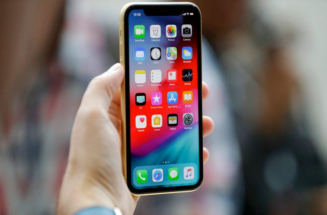 This Sept. 12, 2018, file photo shows an Apple iPhone XR on display in Cupertino, Calif. A Chinese national in Oregon sent hundreds of supposedly broken iPhones to Apple over two years, and got replacements under warranty of almost 1,500 devices.