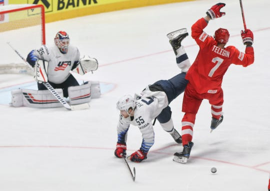 Russia's Ivan Telegin, right, collides with Noah Hanifin of the U.S. during the quarterfinal match Thursday.