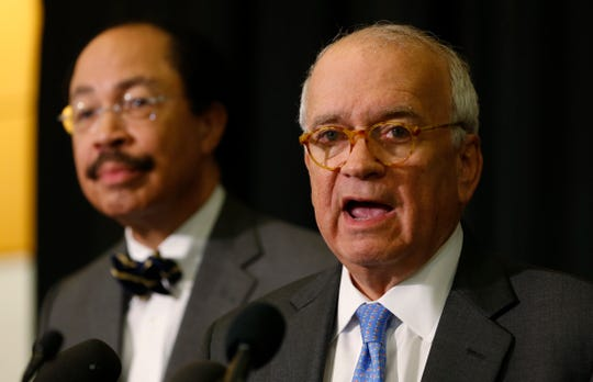 McGuire Woods law firm partner, Richard Cullen, right, speaks during a news conference as Law firm partner George Martin listens during a news conference on a report announcing the results of an investigation into a blackface photo that appeared on the yearbook page of Virginia Gov. Ralph Northam.