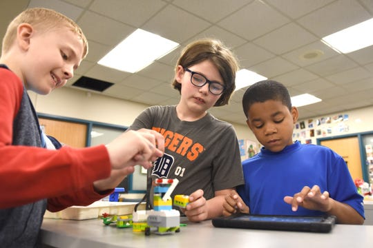 Pattengill Elementary School students Evan Binelli, from left, Sam Dunlap and James Berry work on an extreme earthquake simulation project in the media center in Berkley on May 17. Pattengill students will be returning to school before Labor Day this fall.