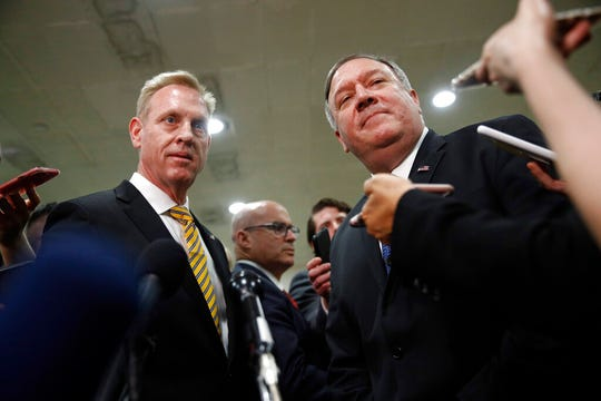 Acting Defense Secretary Patrick Shanahan, left, and Secretary of State Mike Pompeo speak to members of the media after a classified briefing for members of Congress on Iran, Tuesday, May 21, 2019, on Capitol Hill in Washington.