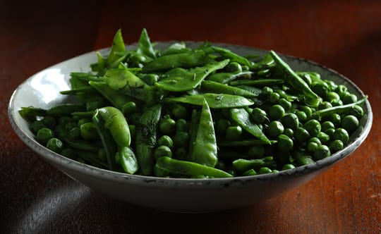A trio of peas -- snow peas, sugar snaps and English -- mix together for a bountiful springtime bowl. After a quick dunk in boiling water, they need just some butter, fresh herbs and a hit of salt. (Abel Uribe/Chicago Tribune/TNS)