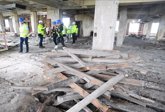 Piles of old lumber are seen on the seventh floor of the Michigan Central Depot building.