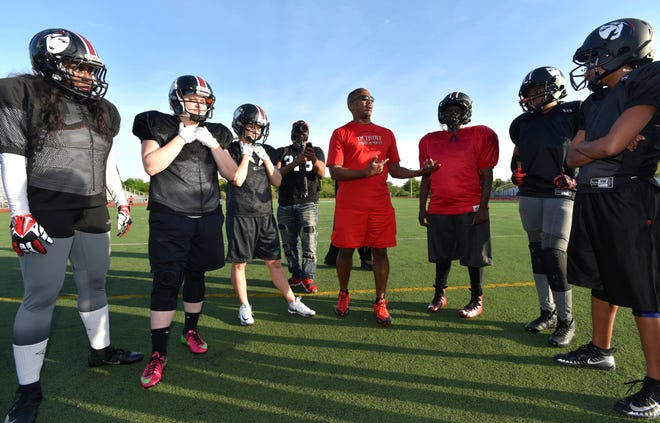 Detroit Dark Angels head coach Keith Thomas, of Troy, talks with his team during a practice earlier this season.