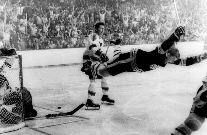 In this May 10, 1970, photo, Boston Bruins' Bobby Orr goes into the air after scoring a goal against the St. Louis Blues that won the Stanley Cup for the Bruins, in Boston. Orr and the big, bad Boston Bruins swept the expansion-era Blues in that series. Now 49 years later, Boston is in its third final in nine seasons and St. Louis is back for the first time since 1970.