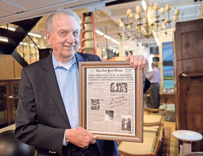 Paul Thal, 78,  with his 1945 New York Times front page displaying the Atomic Bomb attack.
