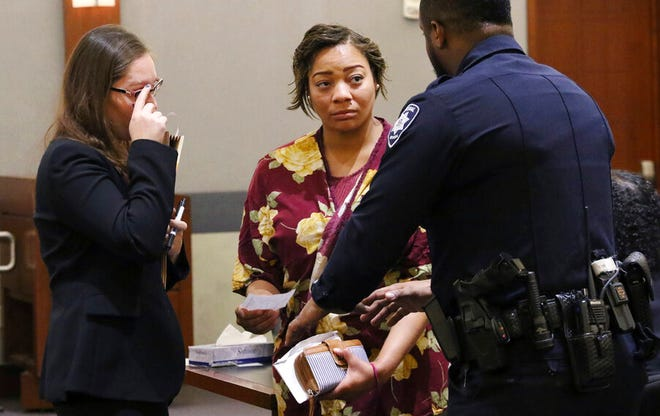 Cadesha Bishop, 25, center, listens to a court officer as her her attorney Baylie Hellman looks on after Bishop's preliminary hearing at the Regional Justice Center on Thursday, May 23, 2019, in Las Vegas.