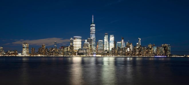 In this Dec. 28, 2018, file photo, One World Trade Center towers above the lower Manhattan skyline and the Hudson River, in New York. Big cities, like New York, aren't growing like they used to.
