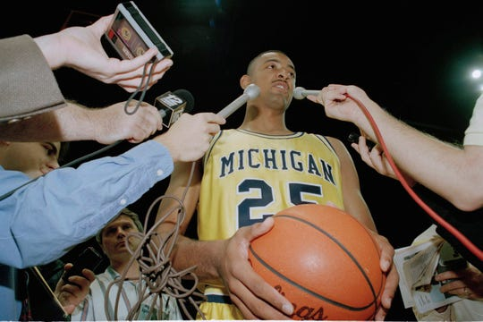 Michigan's Juwan Howard answers questions during Michigan's annual media day on Tuesday, Oct. 26, 1993, in Ann Arbor.