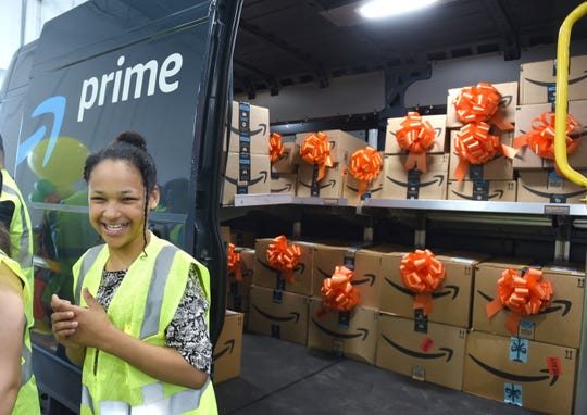 Romulus Middle School student Allyssa Yharbrough shows her excitement after looking inside a delivery van as Amazon donates $10,000 to the Romulus Middle School STEM program.
