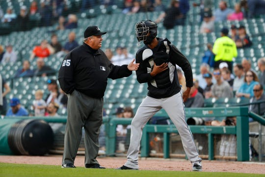 Umpire Fieldin Culbreth tells Miami Marlins pitcher Sandy Alcantara to leave the field before the first pitch.