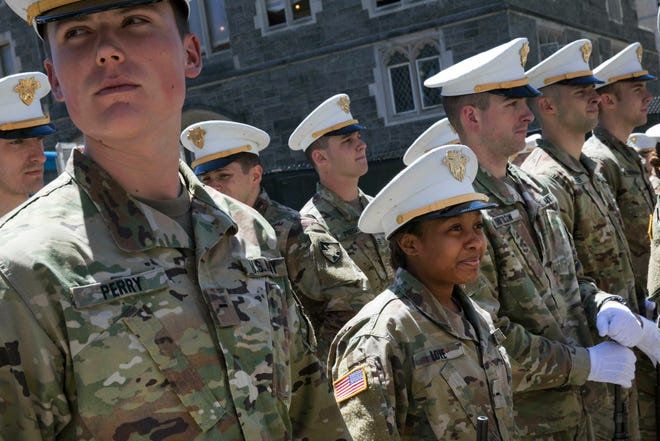 Briana Love, center, and fellow underclassmen prepare to drill at the U.S. Military Academy in West Point, N.Y. The class graduating on Saturday, May 25,  will include 223 women, the largest number since the first female cadets graduated in 1980. It will include 117 African-Americans, more than double the number from 2013, and the largest number of Hispanics, 88.