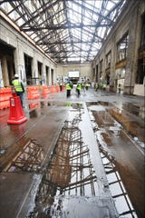 Water reflects the still-open-to-the elements roof on the ground floor lobby area of the former Michigan Central Depot.  Ford faces challenges as the 105-year-old building has been open to the elements for decades and suffered excessive water damage.