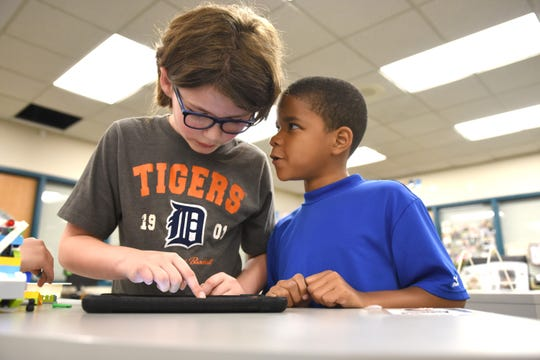 Pattengill Elementary School students Sam Dunlap (left) and James Berry work on an extreme earthquake simulation at the Berkley, Mich. school.
