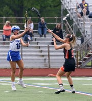 Abigail Christmas of Horseheads passes the ball over Union-Endicott's Emily Roma during the Section 4 Class B girls lacrosse final May 22, 2019 at Ithaca High School.