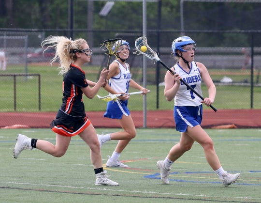 Michaela Elston of Horseheads looks to pass as Kailey Morgan of Union-Endicott defends during the Section 4 Class B girls lacrosse final May 22, 2019 at Ithaca High School.