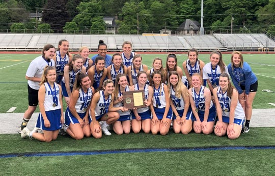 Horseheads poses with its plaque after winning the Section 4 Class B girls lacrosse title with a 21-3 win over Union-Endicott on May 22, 2019 at Ithaca High School.