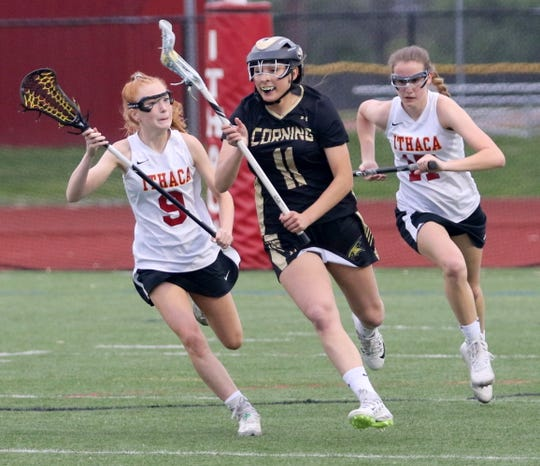 Corning's Kaitlyn DiNardo controls the ball in between Ithaca's Maddison Huddle (9) and Madeline Hall during the Section 4 Class A girls lacrosse final May 22, 2019 at Ithaca High School.