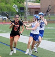 Kelly Kupiec of Union-Endicott controls the ball as Michaela Elston and Delaney Rathbun (6) of Horseheads defend during the Section 4 Class B girls lacrosse final May 22, 2019 at Ithaca High School.