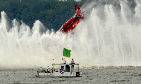 Jeff Bernard in the FormulaBoats.com U-5 flips during a heat at the Thunder On The Ohio hydroplane races July 1, 2007. The race – part of the Freedom Festival – later became Hydrofest.