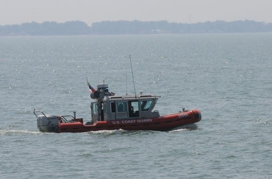 The U.S. Coast Guard patrols the waters of Lake Erie off Catawba Island on Tuesday, Aug 27, 2014. The Coast Guard is urging boaters to exercise caution in the Lake Erie Islands area over Memorial Day Weekend.