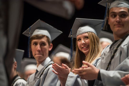 Polaris Expeditionary Learning School graduating senior Brooke Giffin looks on and applauds as fellow graduate Talia Lima heads back to her seat after performing a song during their graduation ceremony on Thursday, May 23, 2019, at the Lincoln Center in Fort Collins, Colo.