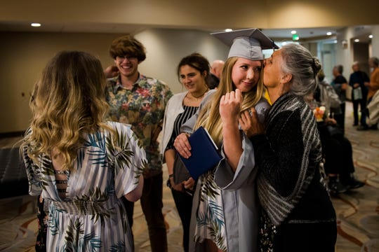 Polaris Expeditionary Learning School graduate Brooke Giffin gets a quick kiss from her mother Diane Giffin while celebrating with her friends on Thursday, May 23, 2019, at the Lincoln Center in Fort Collins, Colo.
