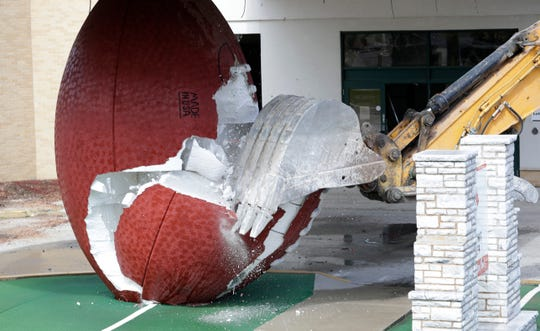 The giant football outside the former Green Bay Packers Hall of Fame on Lombardi Avenue was torn down on May 23, 2019, during the early stages of the Brown County Veterans Memorial Arena and Shopko Hall demolition project. Sarah Kloepping/USA TODAY NETWORK-Wisconsin