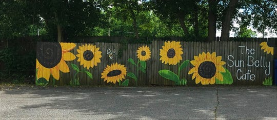 You can find Sun Belly Cafe by its fence decorated with sunflowers.